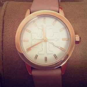 TB pink & gold watch.